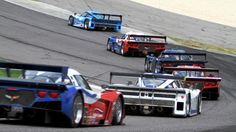 Grand-Am race at Barber Motorsports Park.  From background to fore:  Ford, Chevy, Chevy, Chevy, Ford, Chevy.