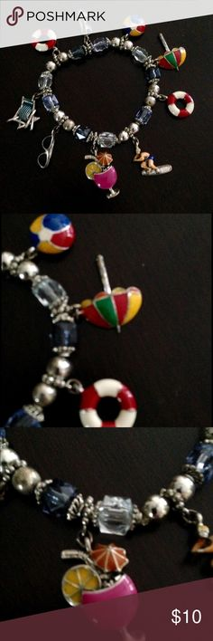 🌴Beach themed charm bracelet w/ enamel charms 🌴Tropical vibe with this Beach themed charm bracelet with elasticized band.enamel paint metal charms - life saver rings, beach umbrella, beach ball, surfer, lounge chair, sunglasses and umbrella drink.colors include red, white, pink, yellow, black orange, blue and green. With silver toned metal beads and faceted beads Jewelry Bracelets