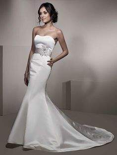 Trumpet / mermaid strapless chapel train glamorous satin with beading wedding dress