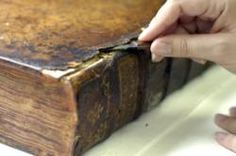 Lifting leather on a damaged volume