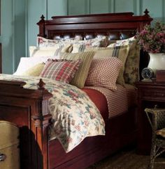 Shabby chic designer bedding and comforter set with vintage style floral quilt and pillow shams for a beach cottage or lake vacation home