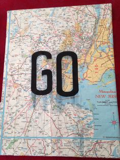 My most recent DIY.   Old wrinkled map + letters + modge podge = newest apartment decoration.