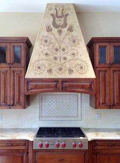Idea for plaster hood surround. Modello® Designs masking stencils helped Surface Refinements, Inc. customize a Hungarian folk design special to their clients.