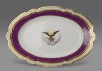State dinner service of Abraham Lincoln (President 1861-1865).--Platter/Made in France, Europe Decorated in New York City, New York, United States, North and Central America c. 1861--Artist/maker unknown, French, for export to the American market. Imported and decorated by E. V. Haughwout and Company, New York, 1857 - 1870. Porcelain with transfer-printed, enamel, and gilt decoration Length: 15 3/4 inches (40 cm)