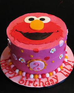 Would be a great cake for a little girl who loves Elmo.