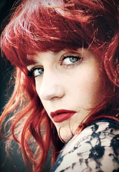 Florence Welch, oh my gosh!! Another one of my favorite female singers, she's lovely :) my favorite song of hers is probably Cosmic Love