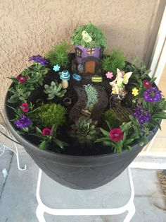 Use an old flower pot as the home for your fairy garden.