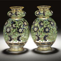 A PAIR OF J. & L. LOBMEYR ENAMELLED 'TURKISH-STYLE' GLASS VASES VIENNA, CIRCA 1878 made for the Turkish market, from the 'Arabian series', each double-gourd form painted and gilt overall with stylised carnations, in the Isnik style, within gilt rims, with everted rim and foot