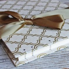 A classic Moroccan design in gold on a cream background. A gold bow ties around the front cover for the finishing touch. ↓ See more details below