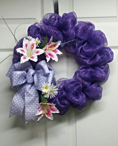 Purple Mesh Wreath with lillies Check out this item in my Etsy shop https://www.etsy.com/listing/271042492/purple-easter-mesh-wreath-purple-spring