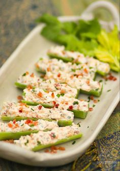 Celery stuffed with cream cheese, bacon, herbs and cheddar cheese are outrageously good! Served as an or snack, this is a recipe that's sure to become a favorite at parties, BBQs and family gatherings. Easy To Make Appetizers, Appetizer Recipes, Keto Recipes, Cooking Recipes, Healthy Recipes, Party Appetizers, Healthy Appetizers, Healthy Snacks For Parties, Good Snacks