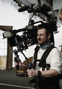 Director Lars von Trier behind the camera on the set ofDogville(2003).