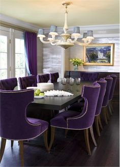 Dramatic Transitional Dining Room by Drake Design Associates - Regal purple dining chairs and drapery panels infuse vitality and are balanced by a shimmering silver wall treatment which opens up the room.