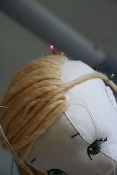 Doll Hair Tutorial (Ponytails) Added August 2012:  For more in-depth instructions on doll hairstyles, a step-by-step tutorial (and templates) for embroidering eyes and faces, and patterns for 16 vintage-inspired dolls and toys (including the dolls below!!!), please refer to my book, a Fall 2012 release from Stash Books.