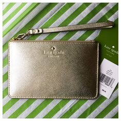 "♠️ NWT Kate Spade Gallery Drive Kerr Wristlet ♠️ ♠️ Authentic NWT Kate Spade Gallery Drive Kerr Wristlet in Gold ♠️ Kate Spade Item #PWRU4727 ♠️ Brand new with tags and care card, perfect new condition! ♠️ Dimensions: 4.1"" x 6.4"" ♠️ Embossed Saffiano on Cowhide with Matching Trim and 14-Karat Gold Plated Hardware ♠️ Le Pavillion Dot Print Interior Fabric ♠️ Zip top wristlet with removable strap for easy conversion to wallet or pouch ♠️ Gold foil embossed KSNY logo with spade hardware stud ♠️…"