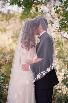 "The ""veil kiss"" is a favorite must-have photo with brides, and this one is especially dreamy."