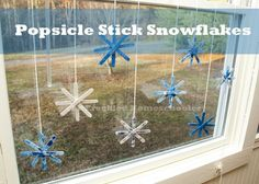 A winter window display: Popsicle stick snowflakes