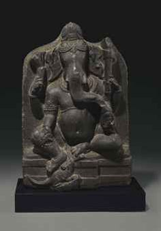 A black stone stele of Ganesha Northeastern India, Pala period, circa 10th century Seated in lalitasana with his pendant foot resting on the rat, holding a mala, radish, axe and bowl of sweets in his four hands, dressed in a short striated dhoti and adorned with various jewelry, the face with curling trunk and elongated eyes flanked by wide ears and surmounted by a low chignon secured with a jeweled headband 21 in. (53.3 cm.) high