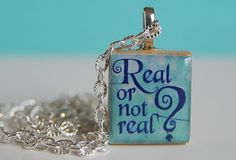 Hunger Games Pendant Real or Not Real by shimmerystuff on Etsy, $6.95