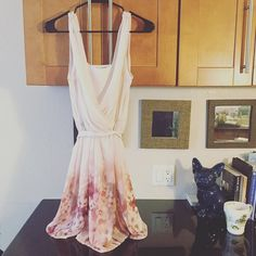 Lauren Conrad Floral Surplice Chiffon Dress My mom bought the dress for me and its never been worn. Just been hanging in my closet. Has detachable lining in the inside and a ribbon belt around the dress. LC Lauren Conrad Dresses