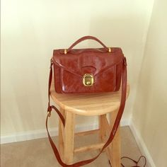 Vintage inspired brown faux leather bag UO In great condition, only minor signs of use on back as pictured. Key included! Urban Outfitters Bags
