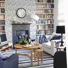 built-in booksheves and cast iron fireplace surround.