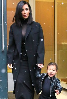 Before her tantrum: Kim and North were spotted leaving Kanye's NYC apartment hours before the NYFW show