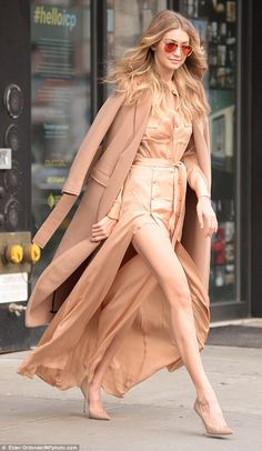 In the nude: Gigi Hadid was a colour co-ordinated dream in an all-nude outfit as she stepped out of her New York City apartment on Tuesday