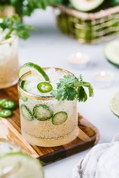 These Cilantro-Infused Spicy Jalapeno Margaritas are the perfect drink for all your entertaining need. They are made with Powell Mahoney's Spicy Jalapeno Margarita mix. I infused them with fresh cil Cocktails Champagne, Mexican Cocktails, Summer Cocktails, Cocktail Drinks, Cocktail Recipes, Cocktail Garnish, Sangria, Jalapeno Margarita, Margarita Recipes