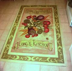 This floor cloth has been on this kitchen floor for nearly 10 years and it has held up beautifully!