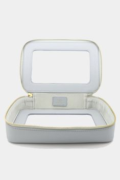 Clear makeup bag in sky blue. This cosmetic bag is designed to hold all your travel beauty essentials, especially when you travel with carry on only. Travel in style with this must have travel essential.