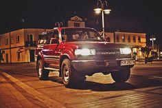 Car in the city night lights land cruiser toyota motor poland polska piaseczno