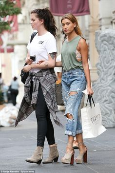 Extremely close: Ireland, 19 led the way as her younger cousin Hailey held her hand through the busy city