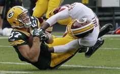 Packers wide receiver Jordy Nelson scores a touchdown despite the effort of Redskins cornerback DeAngelo Hall:  Packers 38, Redskins 20