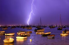Lightning striking over boats in harbor, Poole, England. (© Dan Kitwood/Getty Images)
