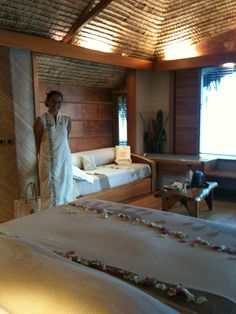 Our lady shows us to our Le Taha'a Private Island overwater bungalow