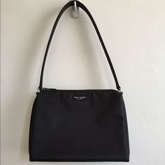 Price Drop! Authentic Kate Spade black nylon purse Classic never goes out of style! Authentic Kate spade shoulder bag firm and structured. Purchased pre-1999 from the flagship store in NYC. used only once for a job interview. In excellent condition. One interior zipper pocket. A simple, classic and minimalist bag goes with lots of outfits and it's big enough to fit all your essential!  Shipping will be on Tuesday 5/31 due to the holiday kate spade Bags Shoulder Bags