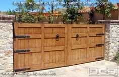 Decorative Hinges Wooden Gates | Rustic wood driveway gate with decorative iron hardware, dummy ring ...