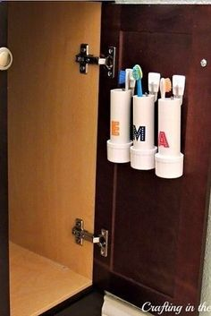 Use Command strips to attach storage pods or PVC pipes to the inside of a bathroom cabinet. | 44 Cheap And Easy Ways To Organize Your RV/Camper
