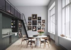 Its a kitchen that actually is so simplistic it serves as a background so you focus on the artwork...gorgeous artwork. I wonder if these are originals.