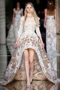 Zuhair Murad Couture Spring/Summer 2016  Long sleeve nude dress featuring an asymmetrical structured cage skirt adorned with white 3D guipure flowers