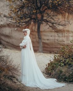 Image may contain: 1 person, outdoor Bridal Hijab, Hijab Wedding Dresses, Hijab Bride, Muslim Women Fashion, Modern Hijab Fashion, White Jumpsuit, Muslim Couples, Wedding Goals, Wedding Photoshoot