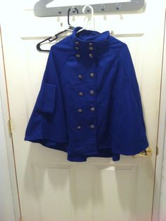 One size, dark blue wool cape. I bough this at a vintage shop but have never worn it. It also doesn't have tags, but it's in great condition. I've never worn it, all buttons are on. It has arm holes and pockets as well. Still thinking about keeping this, so it's up for limited trading.