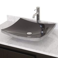 This unique black granite vessel sink quietly draws the focus towards itself without overpowering other decorative elements in your bathroom. The neutral style allows it to be added to your bathroom remodel and complement any design.