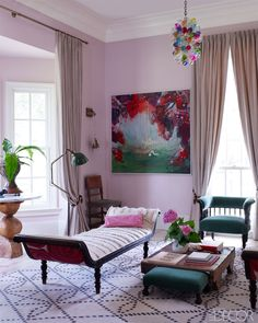 Susan Hable Smith's   Athens Georgia Home  ELLE DECOR    in the parlor:  the antique Indonesian daybed is upholstered with antique Moroccan wedding blankets. - Like the global mix.