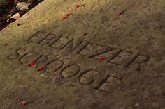 """This is the gravestone of the fiction character Ebenezer Scrooge in the churchyard of St Chads in Shrewsbury, England. Not actually sure who is actually under this stone (The stone was engraved for the film from a Charles Dickens book """"A Christmas carol"""" on an existing gravestone.)"""