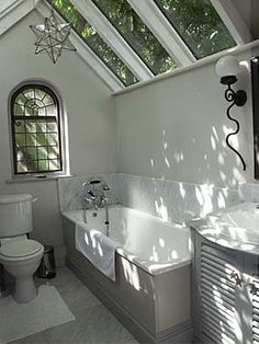 Glass roof bathroom, how wonderful, it would almost be like having a bath outside looking up at the trees.