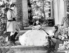 "GWTW: deleted scene (Fred Crane (left) George Reeves - Fleming felt the green ""barbeque dress"" was shown too often, so the scene was reshot with Scarlett wearing the white ""ruffle dress"".)"