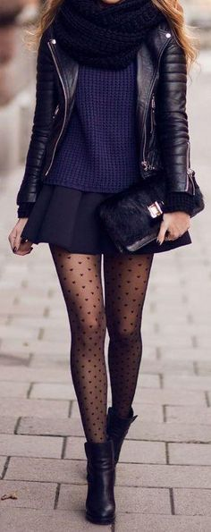 Short flared skirt, knit top, leather jacket, tights and boots