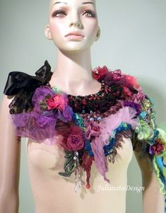 This unique, feminine and very stylish accessory was made using variety of techniques - freeform knitting, crocheting and hand embroidery. Only top quality imported materials, like Italian cotton and silk, baby merino, French and antiqued lace, silk and chiffon flowers etc… were used to make this SIGNATURE ACCESSORY. It is a truly unique, ONE-OF-A-KIND PIECE OF WEARABLE FIBER ART IMPOSSIBLE TO REPRODUCE. The delicate embellishments and big array of crocheted flowers are hand embroidered…